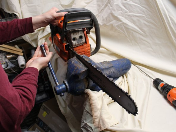 Stabilize the chainsaw using a mounted clamp.