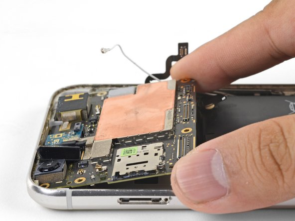 Hold the motherboard by the corners and maneuver it out of its recess, being careful not to snag any cables.