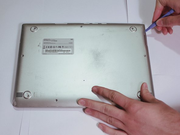 Pry off the bottom cover using a plastic opening tool.