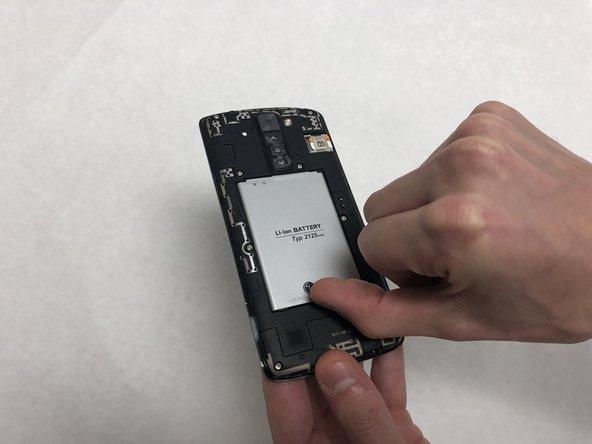 Insert a fingernail in the notch under the battery.