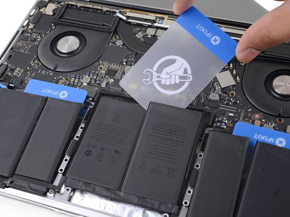 The final battery cells can be more difficult to remove. If needed, apply more adhesive remover to make the job easier.