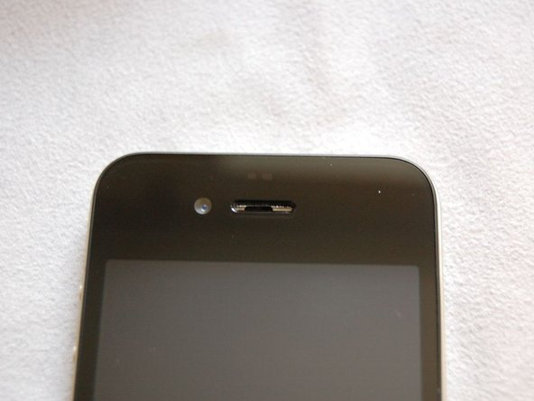 Left image shows iPhone with missing front dust mesh