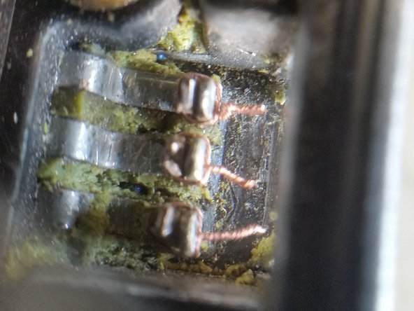 Wrap some wire strands around the terminal ends to help hold them together tightly. Solder the terminals together (but NOT to each other!).