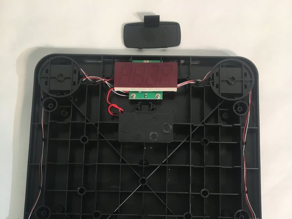 Use wire strippers to cut the wired connection to the power supply.