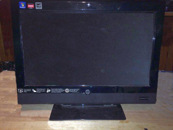 HP310-1037 Touchsmart PC with a dead hard drive. The hard drive is located behind the stand cover.