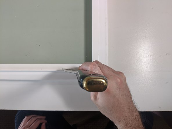 Remove the slider portion of the window from its frame and place it on a flat, soft work surface before beginning.