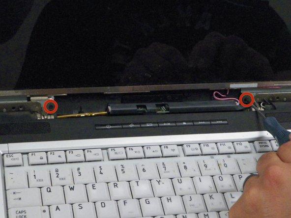 Remove 2 Phillips 5.6 mm screws from below screen.