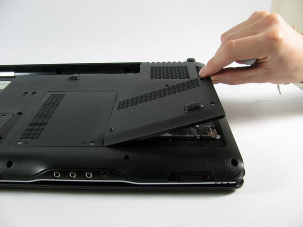 After removing the two cover screws, lift and slide the cover out of position to access the hard drive.