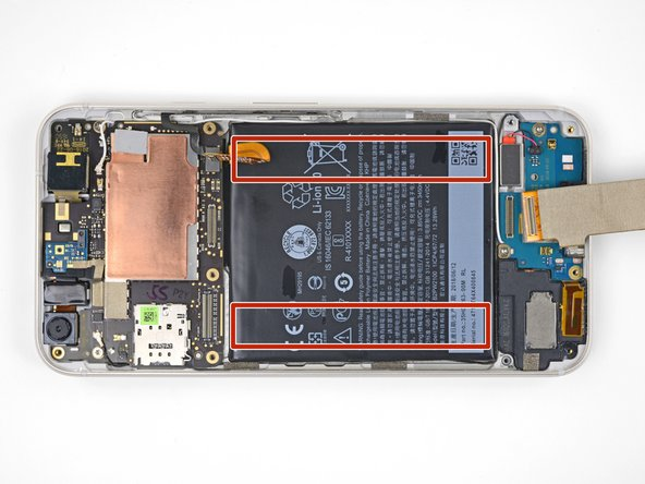 The battery is secured by two strips of double-sided tape.