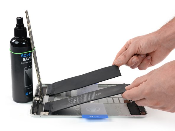 Get a good grip on both sides of the battery and remove it from the iPad.