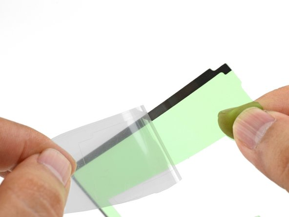 Peel off the clear plastic backing from the U-shaped adhesive, exposing one side of the adhesive.