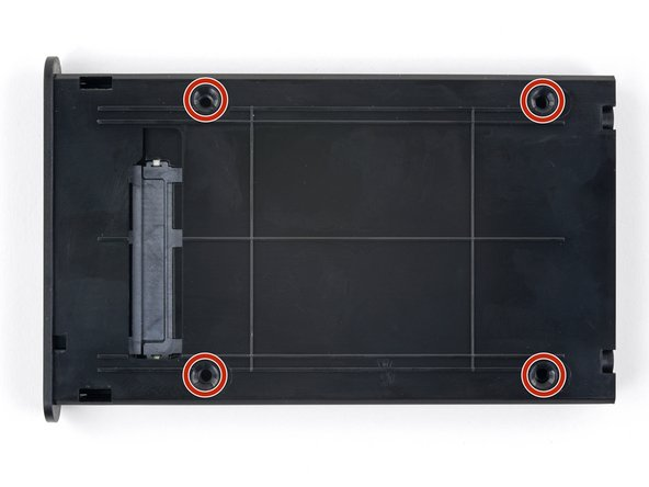 Flip the drive tray over.