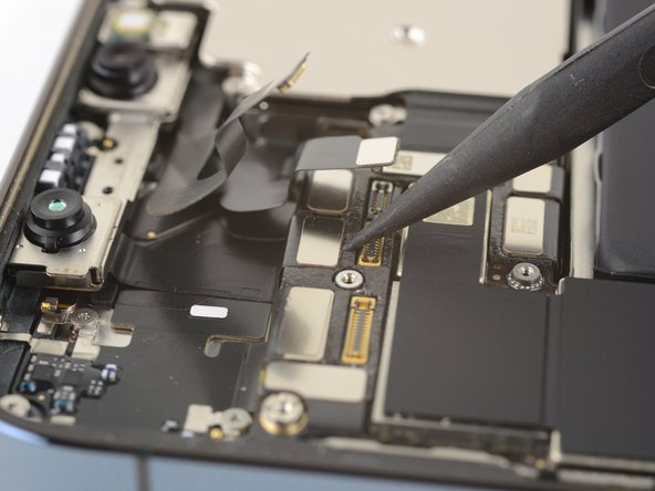 Gently push the Face ID cable connectors away from the logic board to access the selfie cam connector underneath.