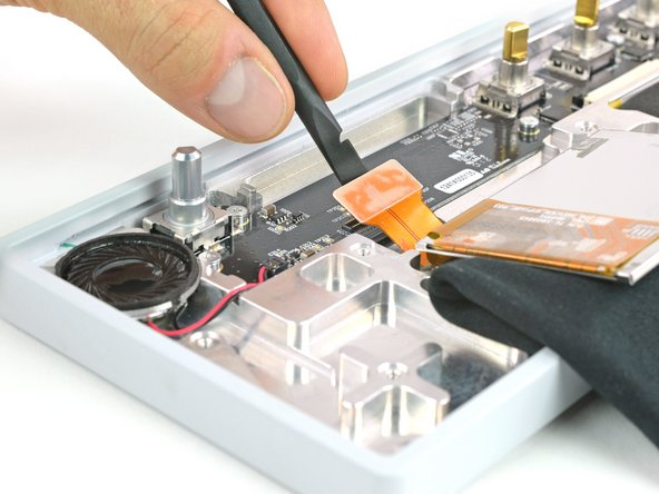 Unplug the DSP flex cable from the UI board.
