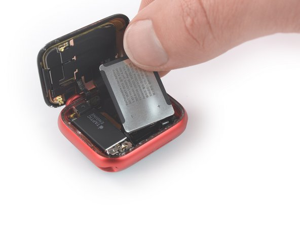 The battery flex cable is long enough to allow you to place the battery outside the watch case, but avoid straining the cable when you lift the battery out of its recess.