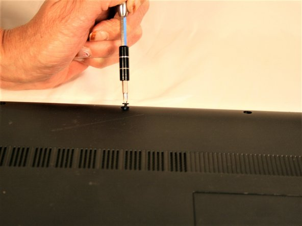 Remove the three #00x5.5mm screws from the bottom front under panel and then slide the main access panel forward and out.