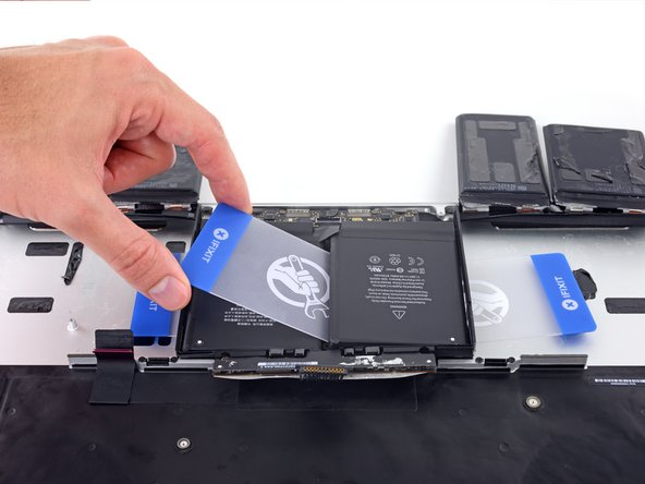 Remove the first card that you  inserted under the final battery cell.