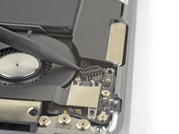 Slide the tip of a spudger underneath the right speaker cable and pry straight up to disconnect the speaker.