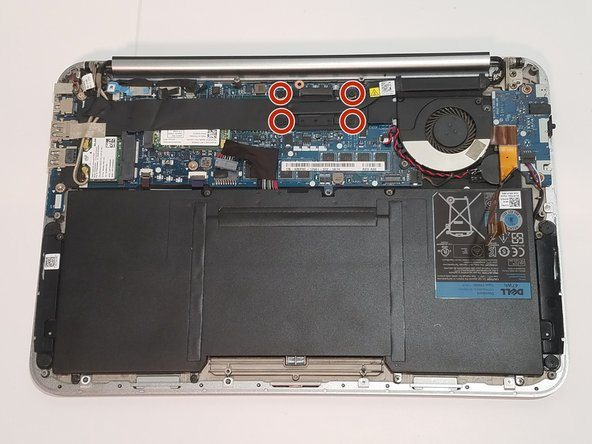 Use a Phillips #00 screwdriver to loosen the screws that secure the heatsink.