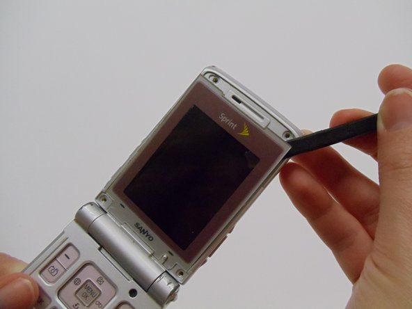 Carefully pry the screen protector off the phone using the flat end of the spudger.