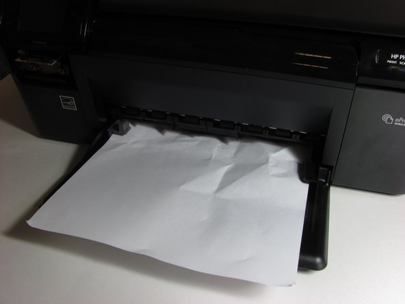 First, identify the location where the piece of paper is jammed.