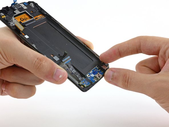 Lift the daughterboard up and away from the body of the phone to remove it.