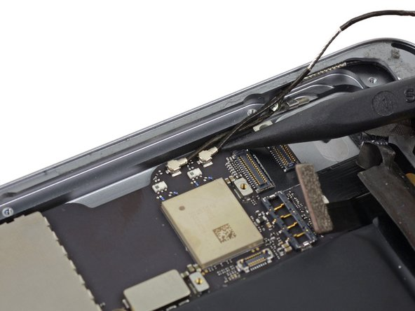 Use the point of a spudger to lift the left antenna cable connector straight up off of its socket on the logic board.