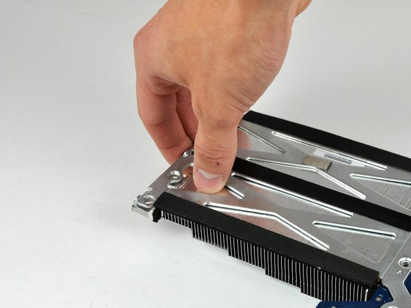 Gently press the heat sink away from the heat sink bracket to separate it from the logic board.