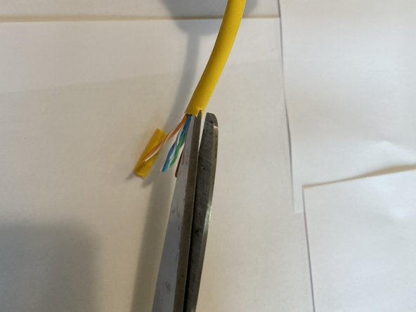 Using your utility scissors, cut a small inlet into the edge of the remaining ethernet jacket.