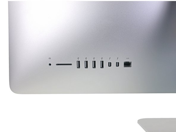 When reassembling your iMac, be very careful to align the exterior I/O ports correctly. The logic board can sit crooked even when secured with all its screws.