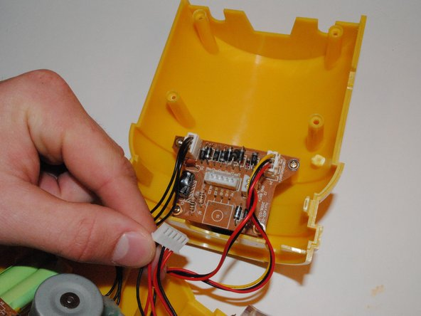 Attach the wires from the LED board and solar panel to the main board where the old wires were removed.