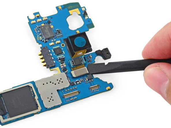 Use the flat end of a spudger to disengage the rear-facing camera connector straight up off its socket on the motherboard.