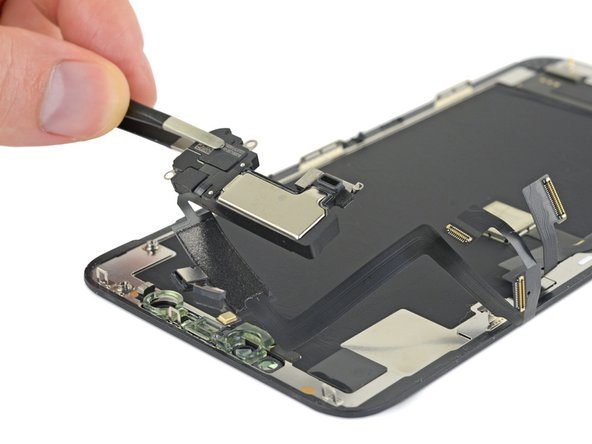 Remove the earpiece speaker and front sensor assembly.