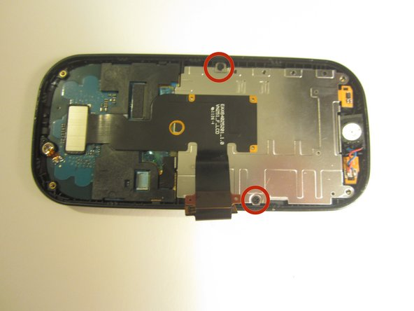 Use a screwdriver and corresponding bit to remove the two 1mm screws. Set the screws aside.