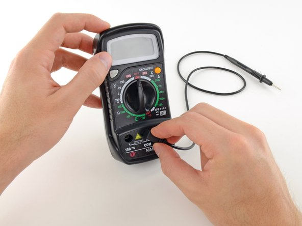 Plug the black probe into the COM port on your multimeter.
