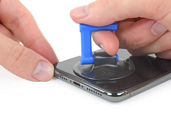 Pull up on the suction cup with firm, constant pressure to create a slight gap between the front panel and rear case.