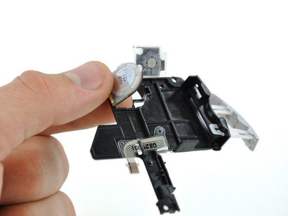 Pop the left speaker out from the bottom of the black plastic bracket.