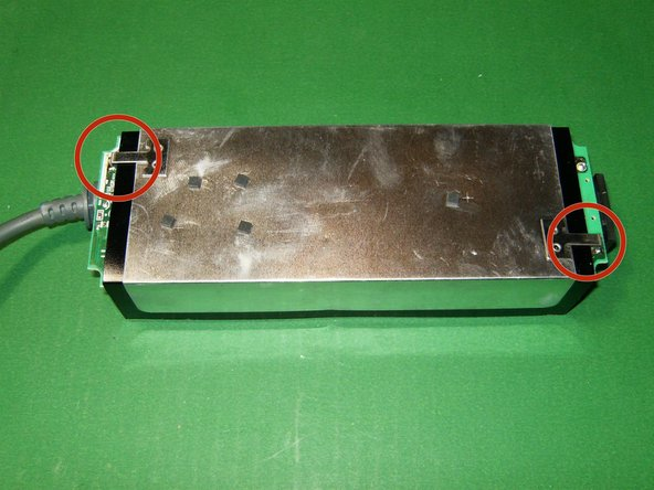 There is large EMI metal shield  soldered to the PCB, that needs to be removed.