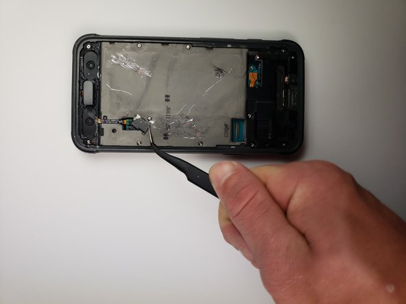 Use tweezers to remove the other small plastic cover.