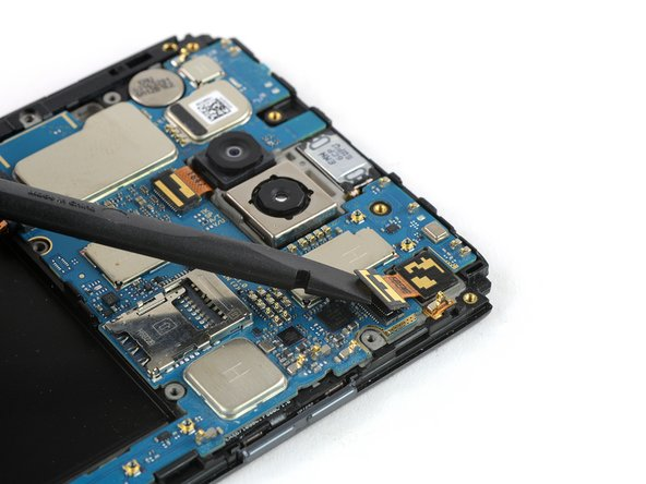 Use the flat end of a spudger to disconnect the front camera flex cable.