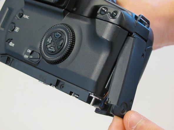 Slide panel toward bottom of camera to remove.