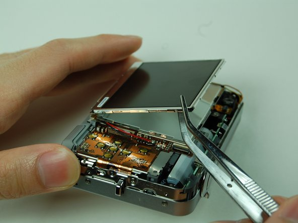 Use the tweezers to lift up the LCD screen.