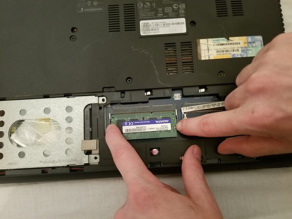Push out the tabs on the other side of the RAM stick.