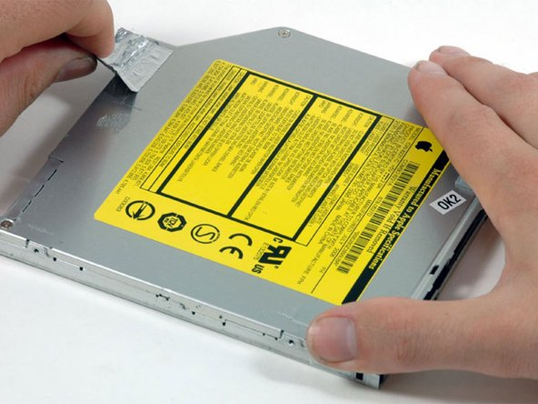 Peel up the silver foil tape from the optical drive.