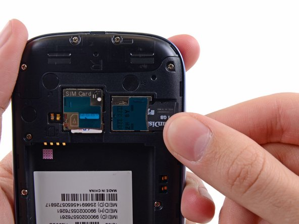 Use your thumb to slide the microSD card out of the slot.