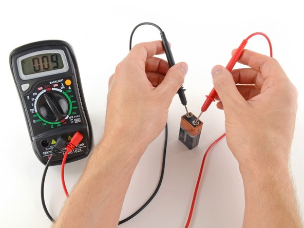 Place the red probe on the positive terminal, and the black probe on the negative terminal.