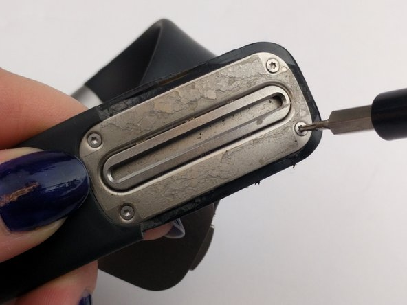 Use a T3 Torx screwdriver to unscrew the four 6 mm screws on the corners of the  metal cover plate.