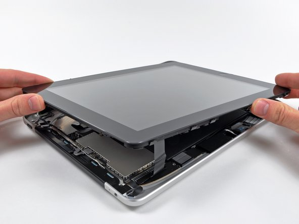 After some careful prying around with a metal spudger, the display assembly can be removed from the rear case.