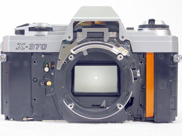 Removing Minolta X-370 Lens Holder