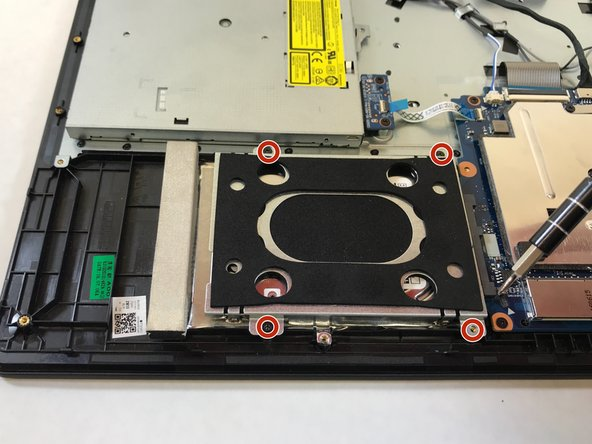 Using a Phillips #1 screwdriver, remove the four (5mm) screws holding the hard drive in place.